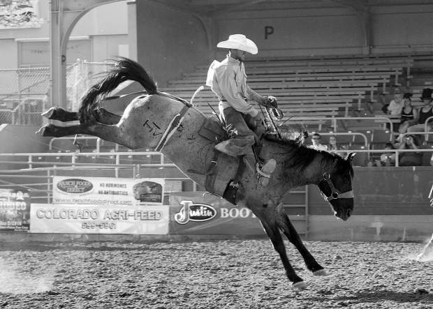 Saddle Bronc riding at a Ranch Rodeo is all about getting the job done. The saddle is a standard working ranch saddle, two hands are allowed, and there are no style points.