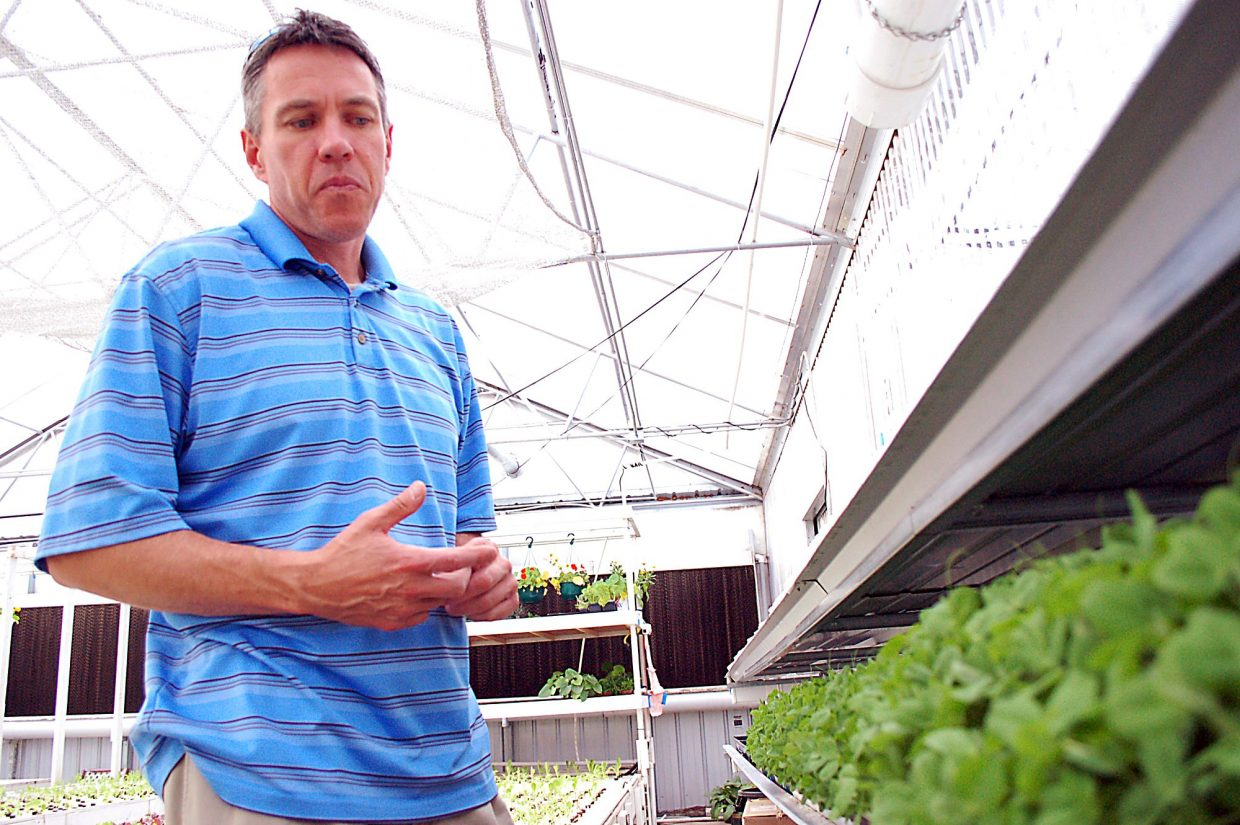 J.D. Sawyer explains the benefits of Aquaponics earier this summer at The GrowHaus in Denver. One of the benefits is that the water used in the system is consistently reused, greatly reducing the amount of water input necessary to grow a crop.