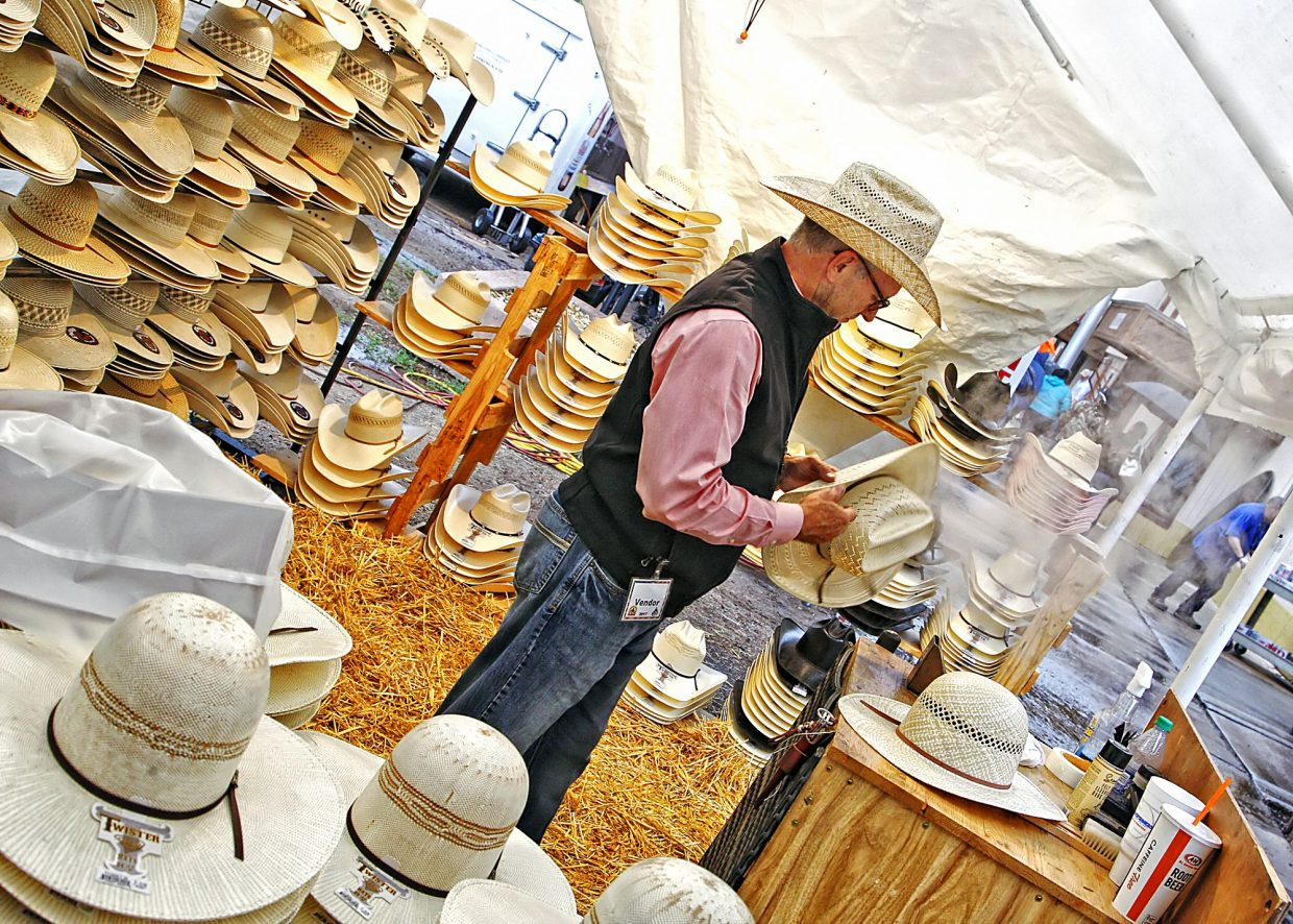 Glenn Orms of The Cow Lot uses steam to help shape a cowboy hat in his vendor tent on the grounds of the 2017 Pikes Peak or Bust Rodeo. Along with Orms' wares, there was plenty of other shopping available at the rodeo.