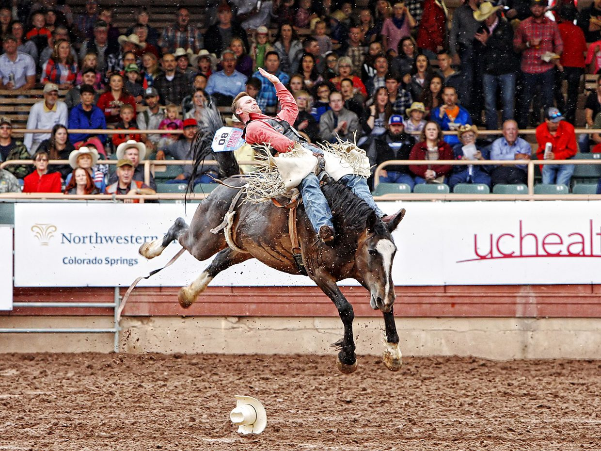 New Mexico cowboy Kory Hart lost his hat and caught some big air in the rain during July 13's performance of the 2017 Pikes Peak or Bust Rodeo in Colorado Springs.