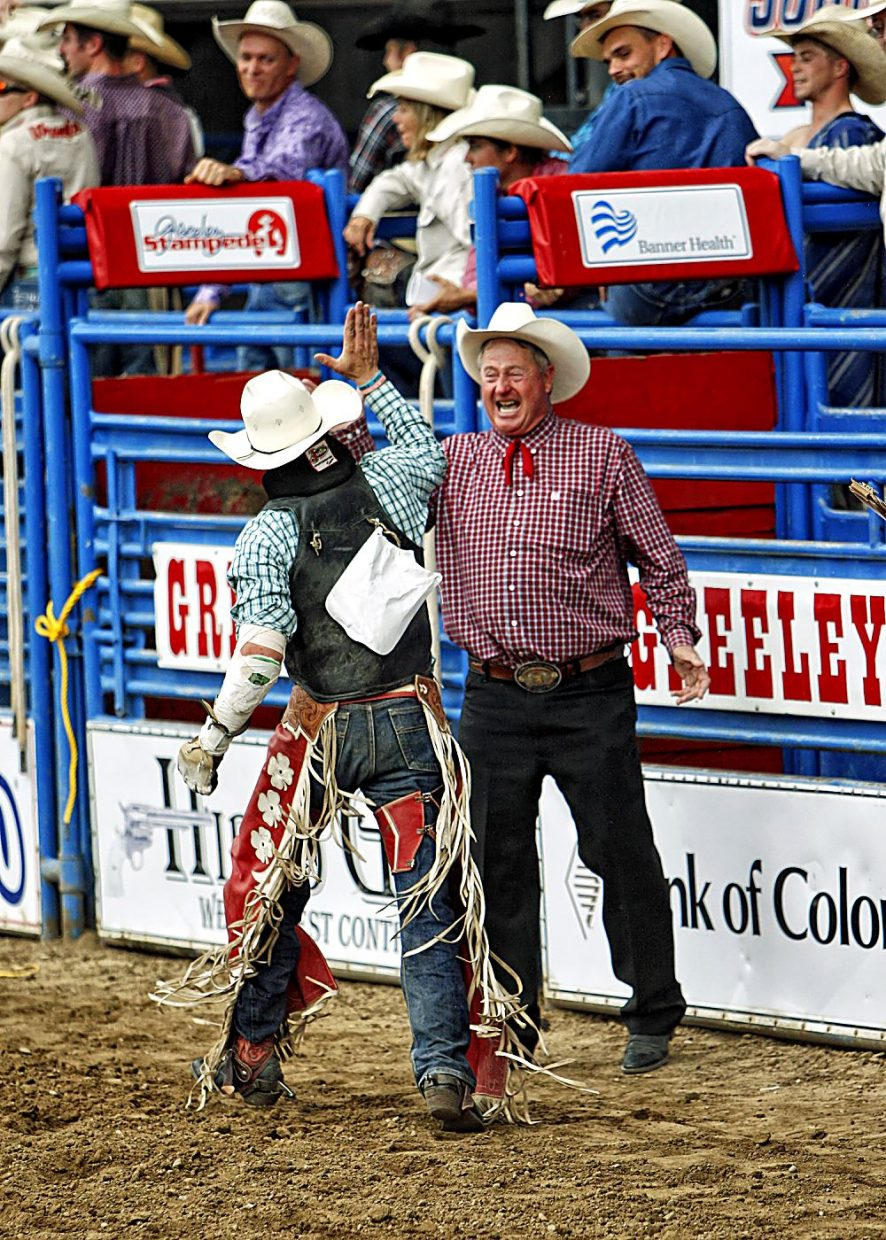 Stock contractor Bennie Beutler had a big smile and a congratulatory high-five waiting for bareback rider Shane O'Connell shortly after O'Connell's arena record-tying score of 89 points flashed on the big screen.