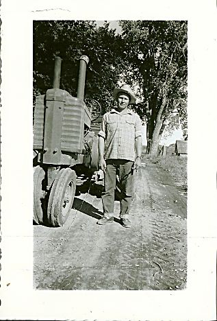 "Charles ""Chuck"" Nelson works on the Nelson family farm east of Longmont, Colo., circa 1952."