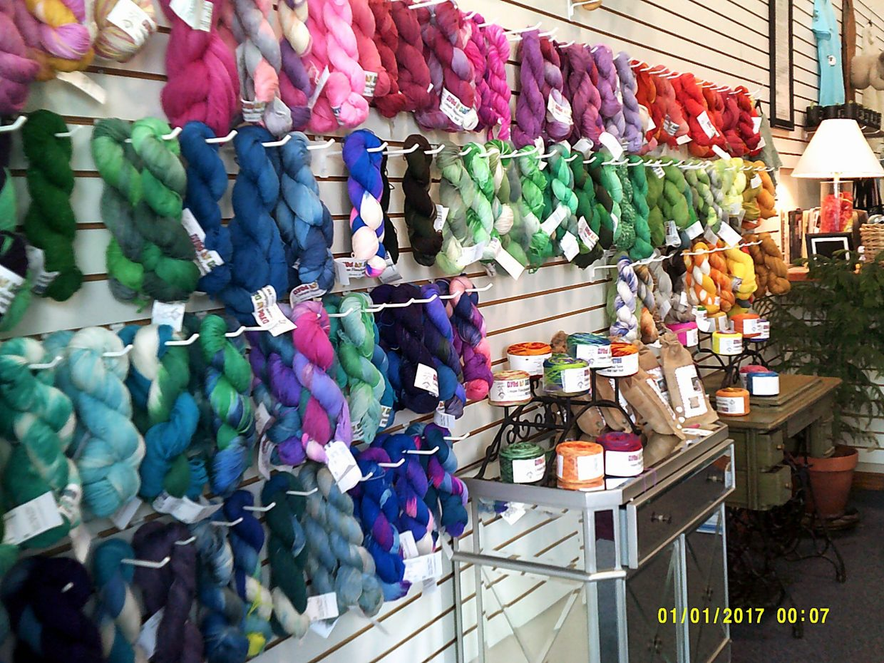 A rainbow wall exhibits the many hand-dyed colors by Darrell Sipes at his family's Fort Collins, Colo., yarn shop, Your Daily Fiber. Species represented include llamas, alpacas and goats.