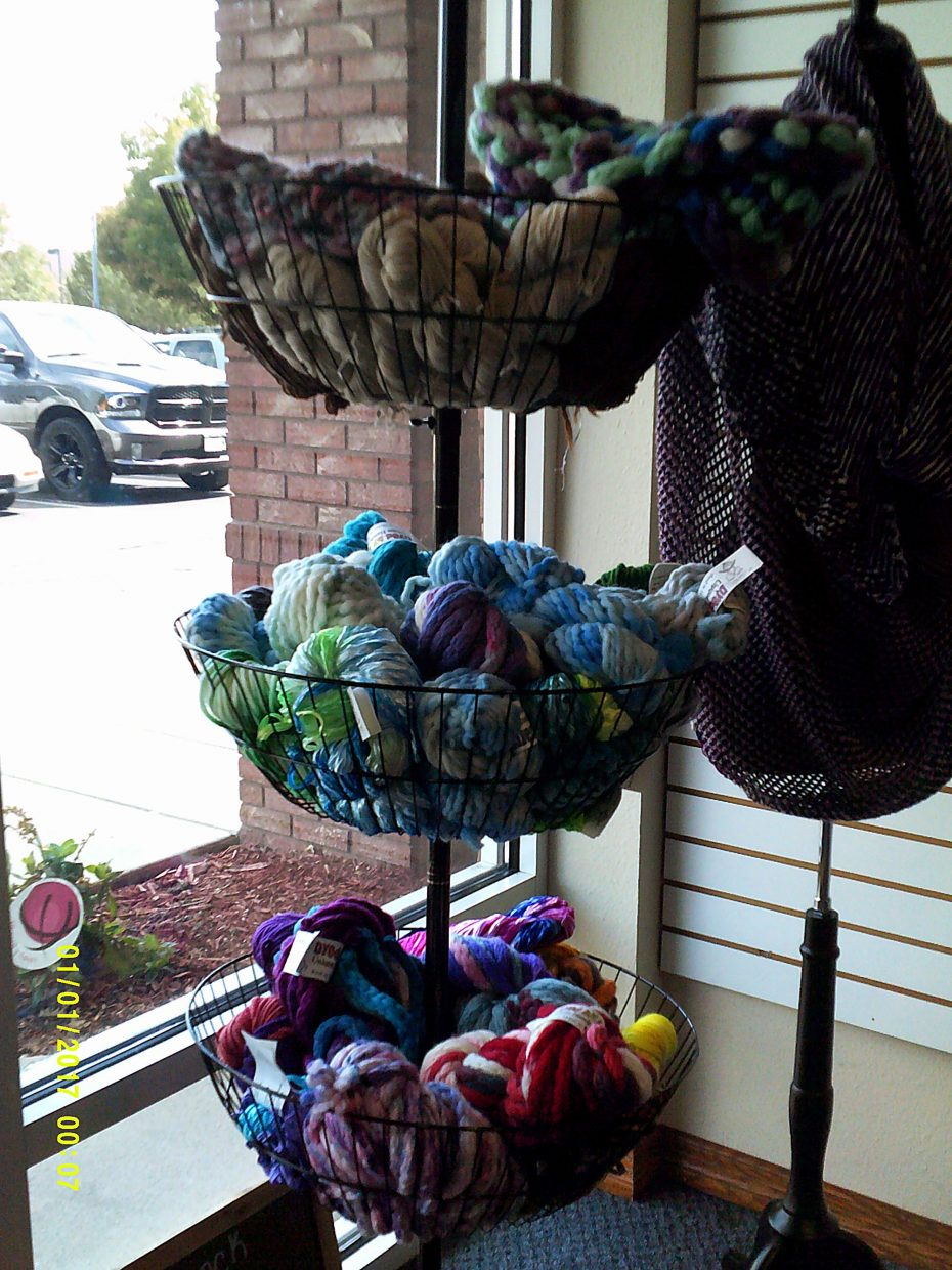 Darrell Sipes hand-dyes animal fiber from many species. Some of his creations in a triple window display and a sweater made from Sipe's colors do their best to entice shoppers into the Sipes family's Your Daily Fiber, a Fort Collins, Colo., yarn store.